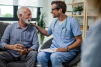 Male Nurse talking with Senior Patient
