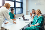 Group of medical staff at table in office setting
